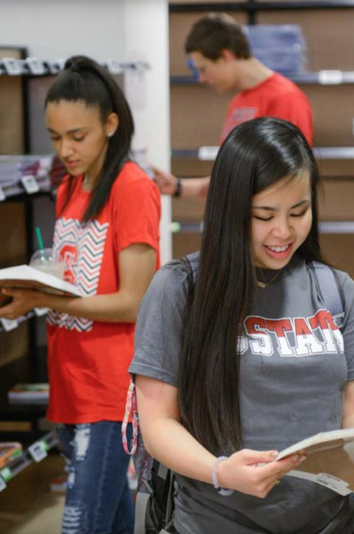 Students shop for textbooks at the bookstore.