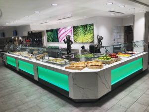 Salad bar with food on it